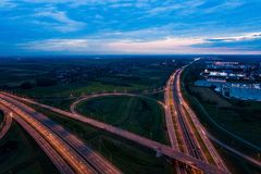 Aerial view on evening traffic on motorway junction. Gliwice, Silesia, Poland royalty free stock photos