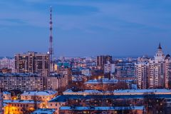 Aerial view of evening Voronezh downtown. Voronezh cityscape at twilight. Modern houses, television broadcast tower.  Royalty Free Stock Photography