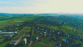 Aerial view of exceptionally beautiful suburban neighborhoods, homes and yards arounds them. 4K. Top drone view of designed mansions, located in amazing rural stock footage