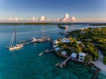 Aerial view of exotic island with authentic buildings and pier for yachts Stock Photos