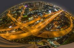 Aerial view of the express way over Bangkok city. Scene with city light, shooting with fish eye lens royalty free stock photo