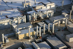 Aerial view of factory. Aerial view of closed auto factory showing numerous exhaust stacks, vents and roofs Royalty Free Stock Image