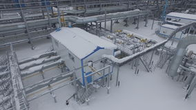 Aerial View on Factory Constructions with Metal Pipes. Aerial view on production factory constructions with metal pipes and white building covered with snow stock video