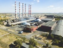 Aerial view of factory pipes emit smoke with harmful substances, air pollution f. Aerial view of factory pipes emit steam smoke with harmful substances, air stock photography
