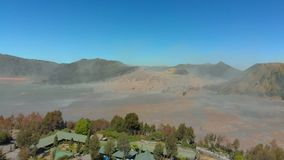 Aerial view on famous active Bromo volcano or Mount Gunung Bromo and Batok volcano inside the Tengger caldera on the