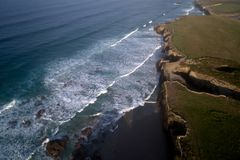 Aerial view of famous beach in Northern Spain in the sunset light. Cathedrals beach at the Atlantic Ocean, Cantabric coast Lugo, Galicia, Spain - Playa de las Stock Photography