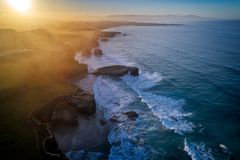 Aerial view of famous beach in Northern Spain in the sunset light. Cathedrals beach at the Atlantic Ocean, Cantabric coast Lugo, Galicia, Spain - Playa de las Stock Images