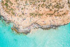 Aerial view famous Blue Lagoon in the Mediterranean Sea. Comino Island, Malta. Beach and vacationers royalty free stock photo