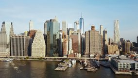 Aerial view of famous city New York, America, Manhattan business district. Drone flying low over the East river and pier