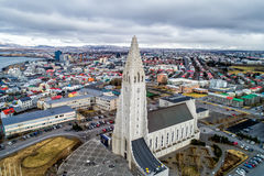 Aerial view of famous Hallgrimskirkja Cathedral and the city of. Reykjavik, Iceland - April 1, 2017: Aerial view of famous Hallgrimskirkja Cathedral and the city Royalty Free Stock Images