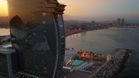 Famous Hotel in Barcelona. Aerial view of a famous hotel in Barcelona, located on beach, sunset time stock footage
