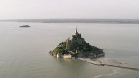 Aerial view of the famous Mont Saint-Michel, a town located in Normandy west of Paris on the small island near the stock footage