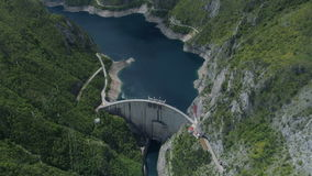 Aerial view of famous Piva Canyon with its fantastic reservoir. Aerial view of dam on famous Piva Canyon with its fantastic reservoir. National park Montenegro stock footage