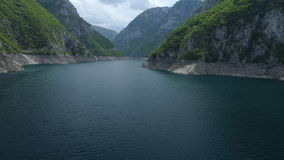 Aerial view of famous Piva Canyon with its fantastic reservoir. stock video footage