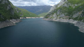 Aerial view of famous Piva Canyon with its fantastic reservoir. stock video