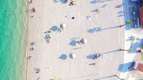 Aerial view of famous white party beach of Pag island, Croatia. Aerial view of people sunbathing and swimming on famous white party beach of Pag island, Croatia stock video