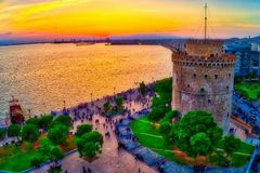 Aerial view of famous White Tower of Thessaloniki at sunset, Greece. Image taken with action drone camera. HDR image. . Dreams filtered image royalty free stock photos