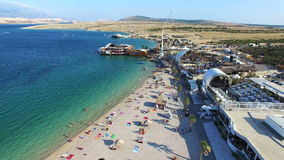 Aerial view of famous zrce party beach of Pag island in the morning, Croatia. Flying above famous zrce party beach early in the morning, Pag island, Croatia stock video