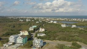 Aerial view of fancy houses, flying above town and beach. 4k. Flying with drone near fancy house in Avon, NC, USA. Aerial footage of ocean, beach and city stock footage