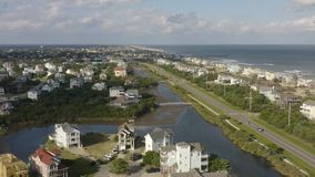 Aerial view of fancy houses, flying above town and beach. 4k. Flying with drone near fancy house in Avon, NC, USA. Aerial footage of ocean, beach and city stock video footage