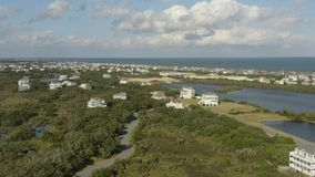 Aerial view of fancy houses, flying above town and beach. 4k. Flying with drone near fancy house in Avon, NC, USA. Aerial footage of ocean, beach and city stock video