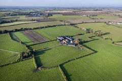Aerial View of Farm and Fields. Aerial view of a farm set amongst agricultural land in Somerset, UK Stock Image
