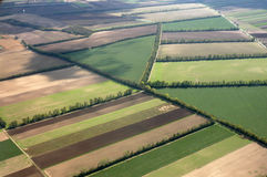Aerial view of farm fields. Looking down from airplane at a colorful patchwork of farm fields in the countryside Royalty Free Stock Images