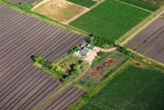 Aerial view of farm with green fields Stock Images