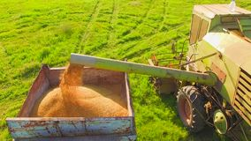 AERIAL VIEW. Farm Machinery Working In Green Field At Harvest Time stock video footage