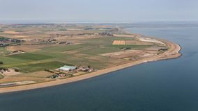 Aerial view east side Dutch island Texel in Wadden sea. Aerial view farmland of east side Dutch island Texel in Wadden sea stock image