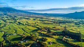 Aerial view on a farmland with stock paddocks at the foot of Mount Taranaki. Taranaki region, New Zealand Stock Photo