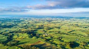 Aerial view on a farmland with stock paddocks at the foot of Mount Taranaki. Taranaki region, New Zealand Stock Photography