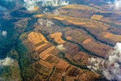 Aerial view Farmland in Tanzania, kraal of the Masai Tribe. Flight over hills with farmland on the way to Ngorongoro Crater in Tanzania. You can see kraals of stock photo