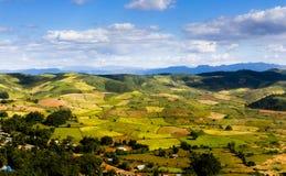 Spring farmlands. Aerial view of rural farmlands landscape under blue sky Royalty Free Stock Photos