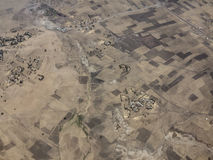 Aerial view of farms in Ethiopia. Aerial view of dry farmland and villages in Ethiopia Stock Image