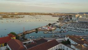 Aerial view of Faro with historic cathedral and marina, Portugal. Aerial view of Faro with historic cathedral in the middle of old town, marina and Ria Formosa stock video footage