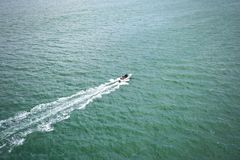 Aerial view of fast motor boat sails on the boundless sea. Leaving a trail behind Stock Photos