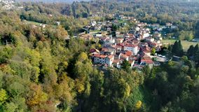 Aerial view of Ferrera di Varese on the hills north of Varese, with Fermona waterfall below. stock footage