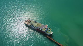 Aerial view of ferry leaving port in tropical country stock video