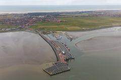 Aerial view ferry terminal at Dutch island Ameland. Aerial view ferry terminal with low tide at Dutch island Ameland in Wadden Sea stock image