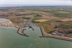 Aerial view ferry terminal Het Horntje at Dutch island Texel. In Wadden sea royalty free stock photos