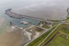 Aerial view ferry terminal at Dutch island Ameland. Aerial view ferry terminal with low tide at Dutch island Ameland in Wadden Sea stock photo