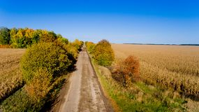 Aerial view of the field autumn road. Aerial view. Aerial view of the field autumn road royalty free stock image