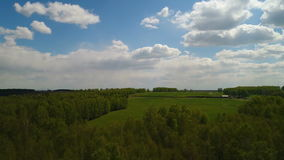 Aerial view of field and forest, clouds, farm stock footage
