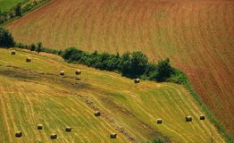 Aerial view of a field and a meadow with hay bales. In late spring, Southern France Stock Photography