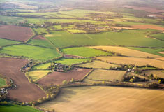 Aerial view on field plots in contrasting colours Stock Photos