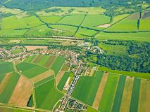 Aerial view: fields and forests, houses and roads stock images