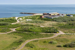 Aerial view at at fields of German island Helgoland. Aerial view at fields of German island Helgoland with youth hostel stock photo