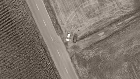 Aerial view of fields and main road. Main road in countryside seen from drone, aerial view. Two cars parked on the field stock video