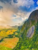 Aerial view of the fields and mountain. Beautiful landscape. Lao. Aerial view of the fields and mountain. Beautiful landscape. Vang Vieng. Laos Stock Photo